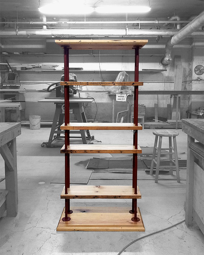The shelves sit on piping and lock into place with pins.