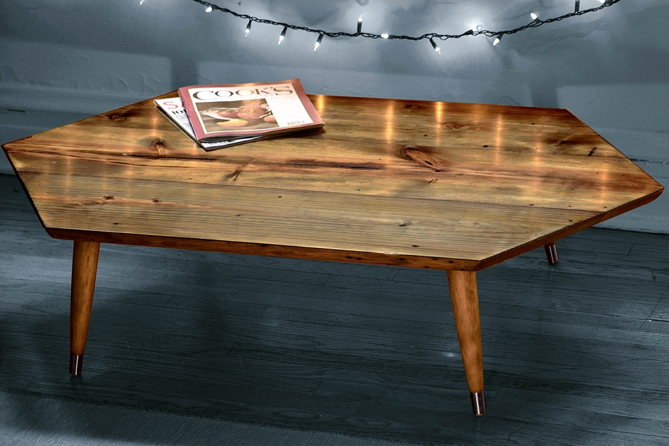 The Agrilinae is a one of a kind studio coffee table. Built and designed here in Chicago, utilizing salvaged Chicago old growth lumber. It's name comes from  a genus of beetle due to their similar atributes of being low lying in form and colored with shades of green, brown and red with a slight iridescence.  Dimensions- L:  4 feet W: 2.25 feet H: 11.5 inches