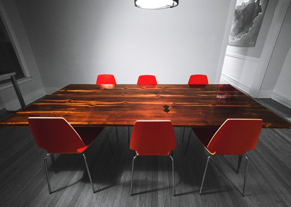 """This is an 8' x 3.5' x 1.5"""" dining room table, built from salvaged old growth lumber. The legs are raw steel, three prong hairpin legs.  The couple that commissioned this table have many potluck and community dinners and needed a finish that was highly durable. Because of this, I coated it with a two part epoxy resin which ends up creating a durable surface much like glass. The size and durability of this table make it perfect for a large dining room and lots of people."""