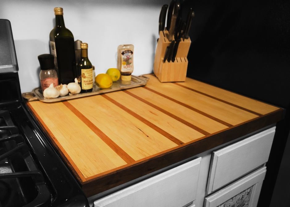This is a cutting board countertop that was installed to replace an unattractive laminate countertop. It was built from Hard Maple, American Cherry, and Black Walnut. It was finished with a food friendly Tung Oil.