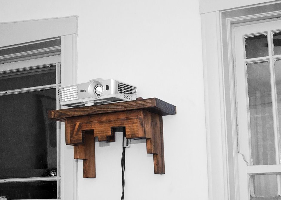 This is a floating projector shelf created from reclaimed old growth lumber, which has been ebonized.
