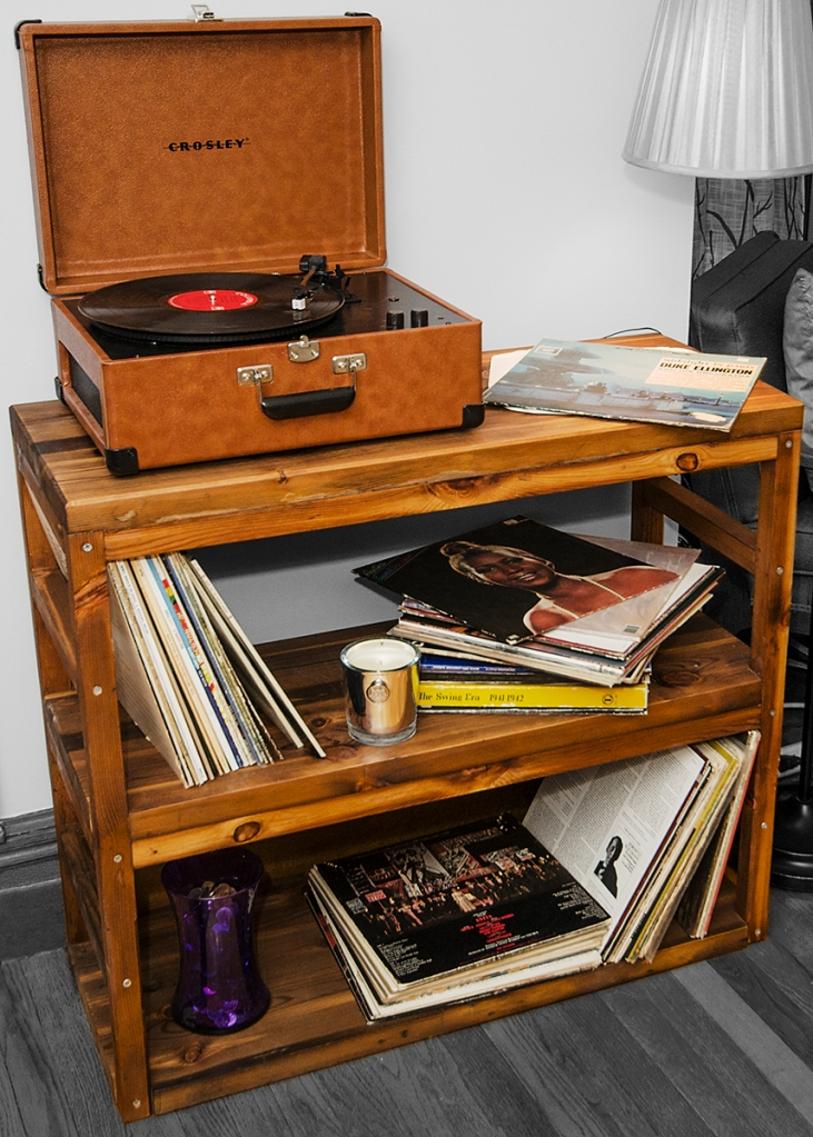 This is a record player stand with two shelves. It was constructed from ebonized old growth salvage.