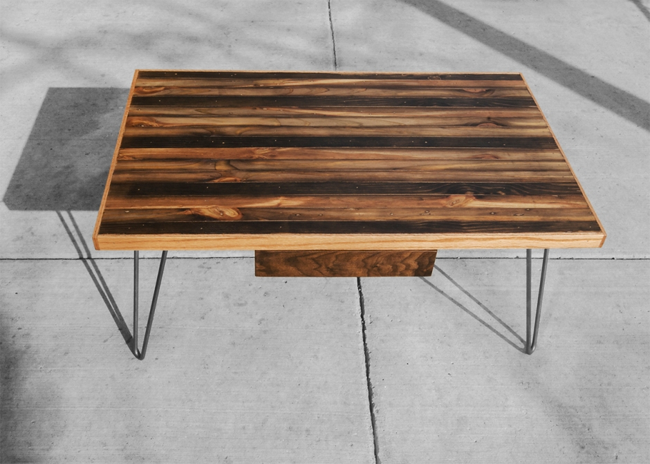 This is a small coffee table built with ebonized, salvaged, old growth lumber. The trim is white oak and the drawer front is black walnut.  It also has raw steel hairpin legs.