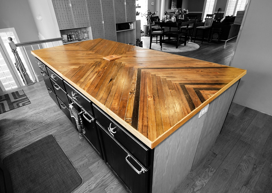 Salvaged Lumber countertop with local hard maple trim. 8.5' x 4'
