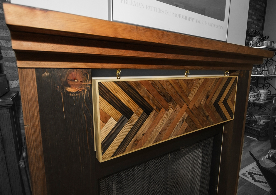 Mantle piece made from salvaged old growth lumber and beam.