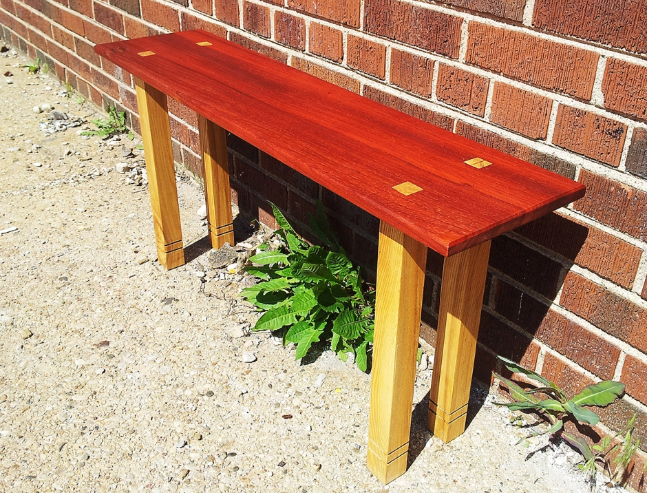 Padouk and Ash bench with through mortise and tenon joints.