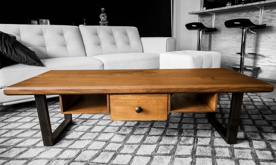 """Made from a solid slab of local (Chicago) Elm, with a walnut stain. 1""""x2"""" raw steel tube legs. The drawer and shelving are also made from the same slab of elm."""