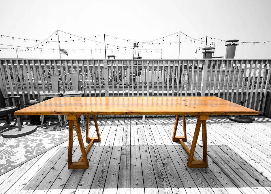 """This table top is made from reclaimed pine and douglas fur from Re-Building Exchange. The """"bowtie"""" joints are functional as well as aesthetic. The sawhorse bases are made from air dried, old growth white oak that was milled from a tree in Chicagos Rogers Park. The table was finished with pure tung oil and marine grade varnish."""
